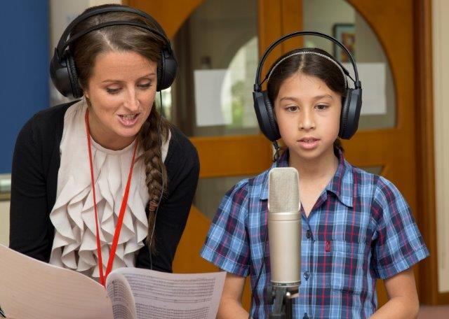 Voices Around The World - Music Adviser Kristina Bourner and young girl at St. Christopher's School in Bahrain
